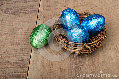 Small bird s nest with four foil eggs