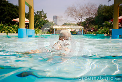 Small Blonde Girl Bathes Laughs In Transparent Water Of Pool Stock Photo Image 61505312