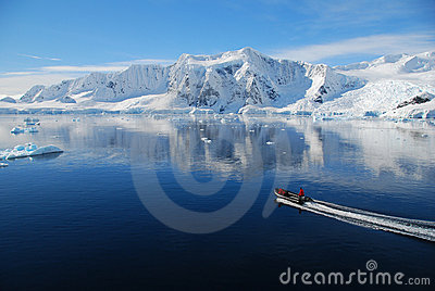 Small boat in antarctic landscape