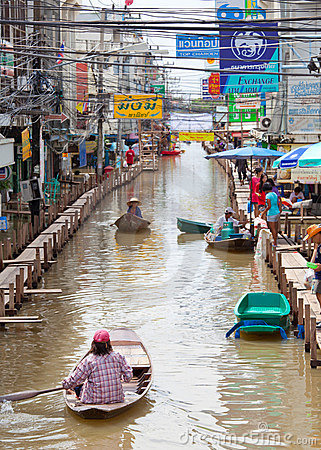Small boat during the monsoon flooding in Thailand Editorial Stock Photo