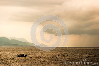 A small boat in the ocean