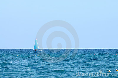 A small boat sailing on a sunny day