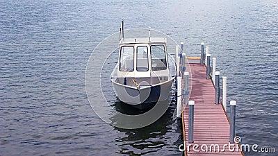 Small boat tied to narrow dock