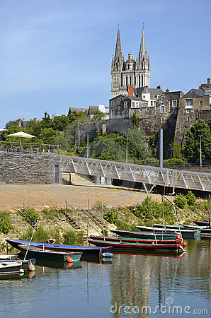 Small boats and Cathedral of Angers in France