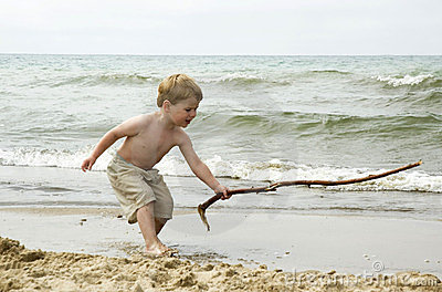 Small boy with a big stick