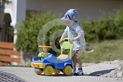 Small boy and car