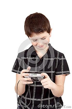 Small boy checking analog camera settings