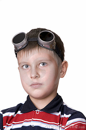 Small boy in dark glasses looking in the camera