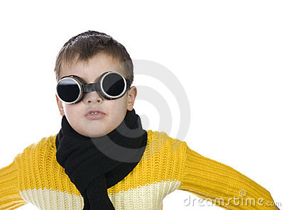 Small boy in dark glasses pretends to be a pilot