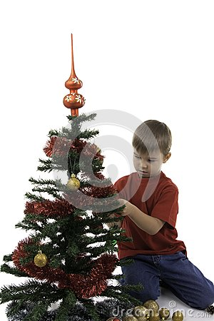 Small boy decorate a New Year tree