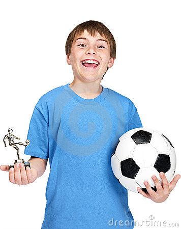 Small boy with football and a winners trophy