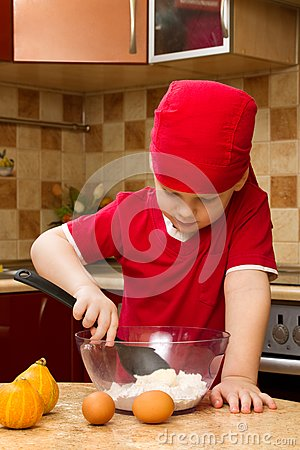 Small boy in kitchen with baking