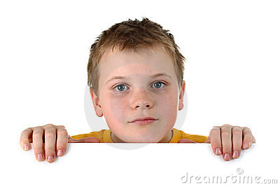 Small boy looking out of a blank whiteboard