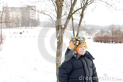 Small boy outdoors in winter snow