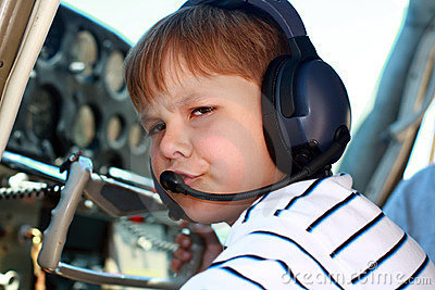 Small boy pilot in private aircraft