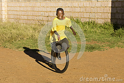Small Boy Playing with Tyre