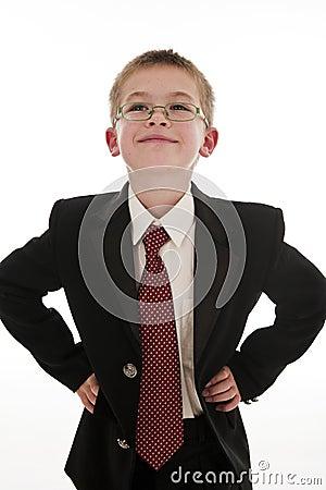 A small boy pretending to be a businessman.