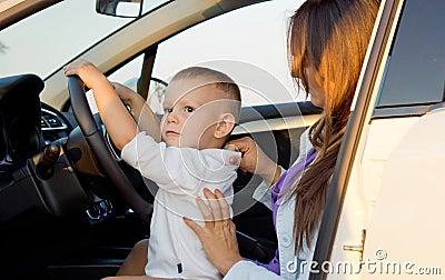 Small boy pretending to drive