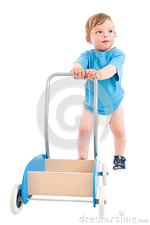 Free Small Boy Pushing Wooden Cart Stock Photography - 25636032