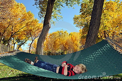 Small boy resting in hammock
