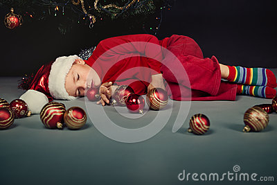 Small boy in santa hat sleep