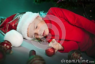 Small boy in santa hat sleep
