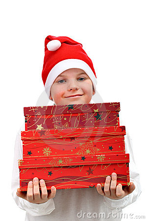 Small boy in Santa red hat carrying three presents