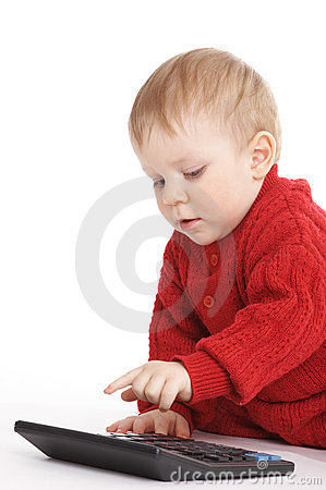 Small boy studies to count with the calculator