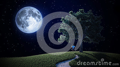Small boy on a swing looking at the Moon