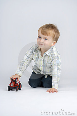 Small boy and toy - car.