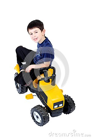 Small boy on the yellow tractor