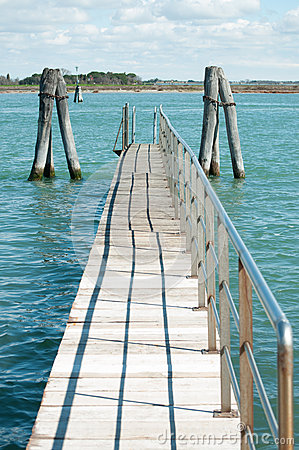 Small bridge over blue laguna water