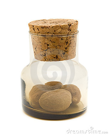 Small brown glass bottle with nutmeg