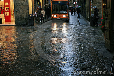 Small bus in narrow streets of medieval town Editorial Photo