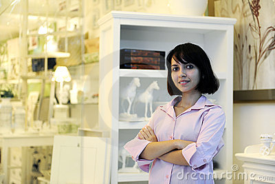 Small business owner: proud woman and her store