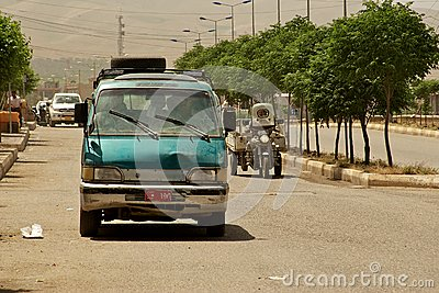 Small busses are the most popular and surprisingly fast means of transportation in Middle East. Iraq Editorial Photo
