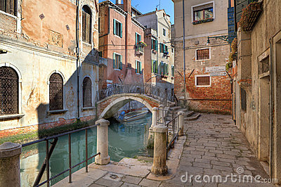 Small canal and old house in Venice, Italy.