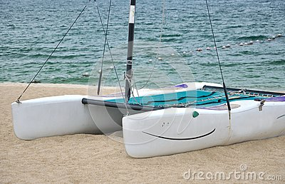 Small catamaran on beach sand
