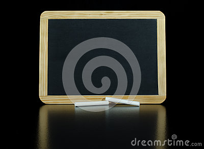 Small Chalkboard on a Black Reflective Background