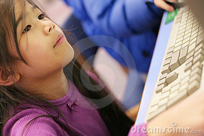 Small child enjoying time on the computer.