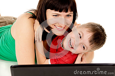 A small child with her mother watch the movie the notebook