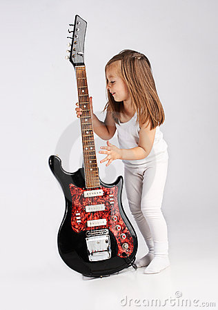 Small child hold red acoustic guitar. Music