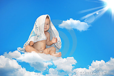 The small child sits on a white cloud