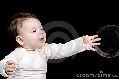The small child and soap bubbles