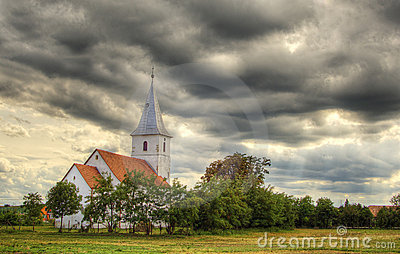 Small church against dramatic sky