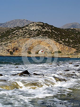 Small church near blue sea