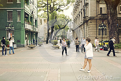 Small city street with pedestrians, people walking in urban street in downtown, street view of China