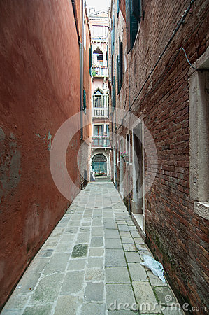 Small colourful venetian street in a popular neighbourhood