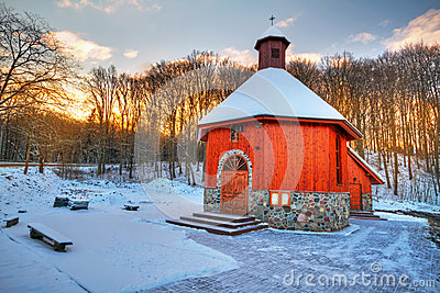 Small cottage church in winter scenery