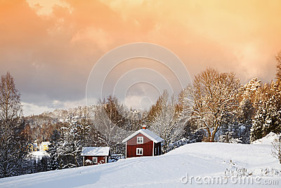 Small cottages in winter landscape